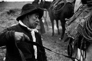 """ARGENTINA. Province of Salta. 1958. An old """"tropero"""" (herdsman) saddles up to herd about 20 cows and drive them to the city of Salta for the cattle sale.BRAZIL. Sao Paulo. 1960. Havana. Ministry of Industry. Ernesto GUEVARA (Che), Argentinian politician, Minister of industry (1961-1965) during an exclusive interview in his office.  CHINA. Beijing. 1964. Tien An Men square in front of main entrance to the """"forbidden city"""". Demonstration against the Vietnam war. BRAZIL. Amazonas. 1977. Village of Patroziño, in the Amazon jungle, one hour by airplane from Santa Rem. It was built by gold miners and called """"garimpeiros"""". ITALY. Sicily. Favignana island. 1956. Tuna fishing (Matanza)."""