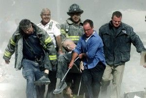 Rescue workers carry fatally injured New York City Fire Department Chaplain, FetherMychal Judge, from one of the World Trade Center towers in New York, in this September 11, 2001 file photo. REUTERS/ Shannon Stapleton