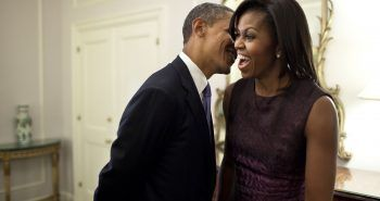 """Sept. 21, 2011 """"The First Lady reacts to something the President whispered to her at the Waldorf Astoria Hotel in between events related to the United Nations General Assembly in New York City."""" (Official White House Photo by Pete Souza) This official White House photograph is being made available only for publication by news organizations and/or for personal use printing by the subject(s) of the photograph. The photograph may not be manipulated in any way and may not be used in commercial or political materials, advertisements, emails, products, promotions that in any way suggests approval or endorsement of the President, the First Family, or the White House."""